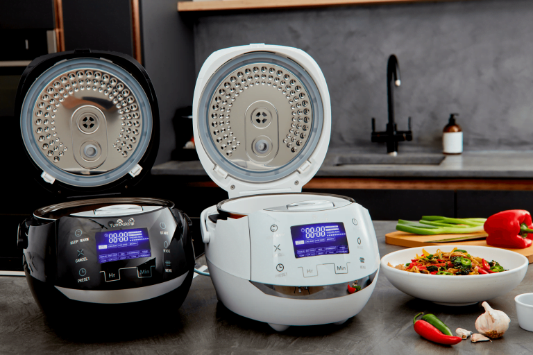 Yum Asia Sakura rice cookers in white nd black colours showing stainless steel inner lids